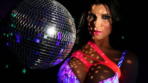 Romi plays with a disco ball before stuffing toying her cunt.
